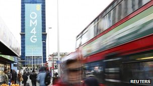 Woman walks past 4G advert