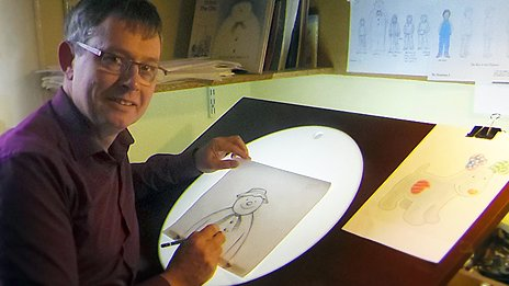 Roger Mainwood drawing The Snowman on a light-box