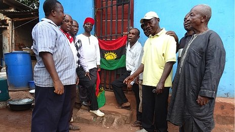 Men sing anthem alongside Biafran flag