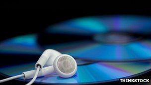 Stock image of earphones and CDs