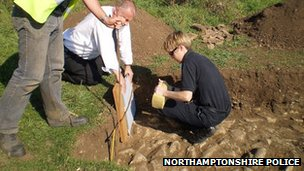 Northampto​nshire Police take a plaster cast of tool marks after Cox and West dug trenches for illegal metal detecting