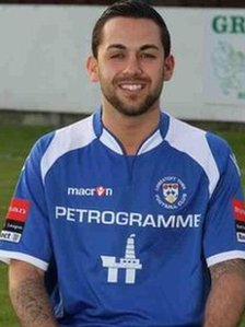 Erkan Okay in the Lowestoft Town Football Club kit