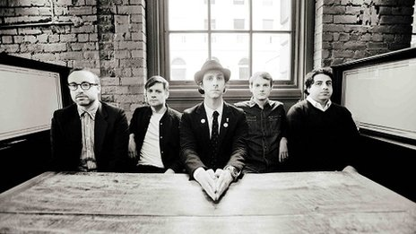 Maximo Park sitting at a table
