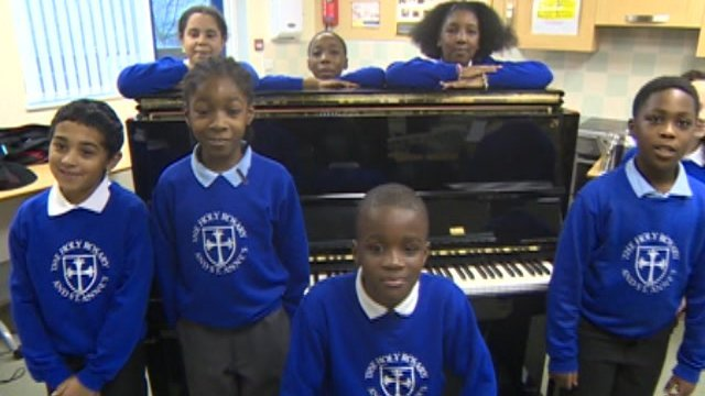 Children standing by the piano