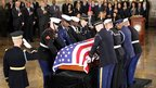 An American flag is draped over the casket of Hawaii Senator Daniel Inouye as he is laid in state in the Capitol, Washington DC, 20 December 2012