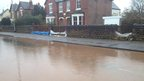 Sand bags outside houses in flood-hit Lowdham