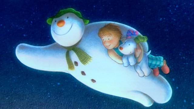 Drawing of snowman holding a boy and his dog