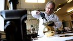 French craftsman Michel Garault works on the FIFA Ballon d'Or 2012 (Golden ball), at the Mellerio jewellery workshop in Paris