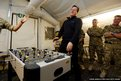 British Prime Minister David Cameron reacts as he plays table football with a Royal Marine during a visit to Forward Operating Base Price in Helmand Province, Afghanistan