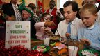 Chancellor of the Exchequer George Osborne paints a moneybox with children at Number 11 Downing Street