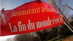 A restaurant touts for business in Bugarach, the small French mountain village that some believe will be spared in the apocalypse