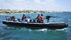 Ugandan marines patrol the coast off Somalia's capital, Mogadishu, on 14 December.