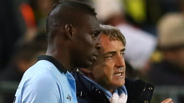Manchester City manager Roberto Mancini with Mario Balotelli