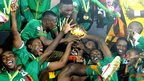 Zambia's national team players celebrate with their trophy after winning the African Cup of Nations in Libreville, Gabon - 12 February 2012