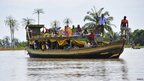 People on a boat in Nigeria's central Kogi state seek refuge after flooding – 28 September 2012