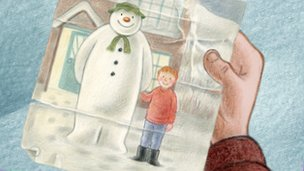 Boy holds a picture of the original Snowman