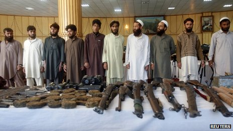 Taliban insurgents and their weapons confiscated by Afghan joint forces during an operation are presented to the media in Jalalabad province