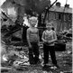 Children pause from their play in a scene reminiscent of a war zone in east Belfast in 1984