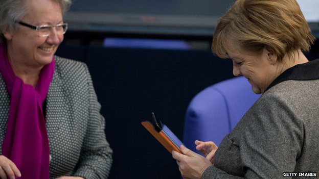 German Chancellor Angela Merkel uses an iPad in the Bundestag