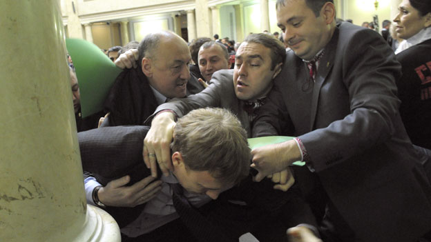 Fight in parliament -  Ihor Miroshnychenko (centre) on the attack