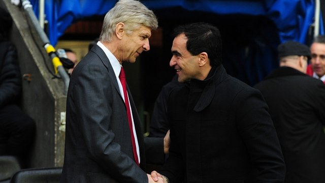 Arsenal manager Arsene Wenger together with Wigan boss Roberto Martinez