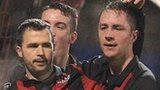 David Rainey scored a late equaliser for Crusaders against Linfield
