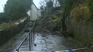 About 30 tons of rubble and soil falling on to a footpath in Swansea