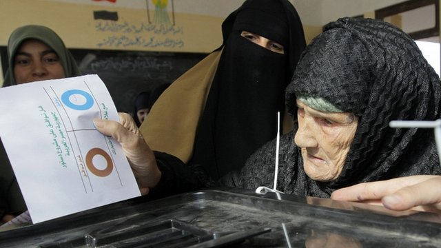 Amnah Sayyed Moussa casts her vote