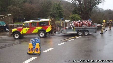 Jersey Fire and Rescue Service crews tackle flooding