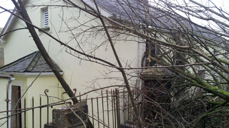 Trees fallen against the vestry of Pantteg Chapel in Ystylafera after the landslip