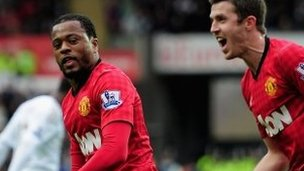 Patrice Evra (left) celebrates scoring for Manchester United