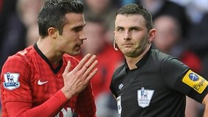 Robin van Persie (left) and referee Lee Probert