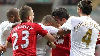 Man Utd striker Robin van Persie (second right) and Swansea defender Ashley Williams are involved in a clash