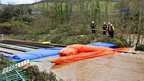 Inflatable dams on a railway line