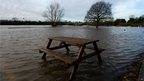 A flooded car park at Gunthorpe on the banks of the River Trent, Nottinghamshire.