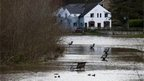 Benches partially submerged by flood waters in Ross-On-Wye, Wales.