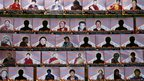 Photographs of Tibetans who have allegedly self-immolated themselves in protest against Chinese rule hanging from a wire during a rally to mark World Human Rights Day in New Delhi, 10 December 2012