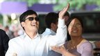 Chinese activist Chen Guangcheng gestures before making remarks to the media upon arriving on the campus of New York University, 19 May 2012, in New York City