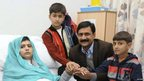 Malala Yousufzai is seen with her father Ziauddin and her two younger brothers Khushal Khan (L) and Atal Khan, as she recuperates at the The Queen Elizabeth Hospital in Birmingham, 25 October 2012.