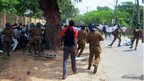 Sri Lankan police clash with university students in Jaffna on November 28, 2012.