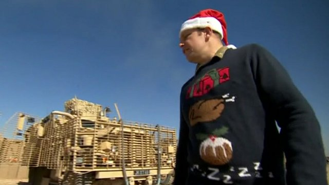 British serviceman wearing Christmas jumper in Afghanistan