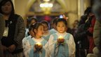 Young Chinese worshippers attend the Christmas Eve mass at a Catholic church in Beijing on 25 December