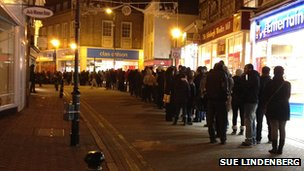 Shoppers queuing up outside Next in Kingston-upon-Thames; picture taken by BBC viewer Sue Lindenberg