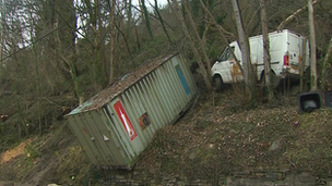 Container and white van caught in landslip