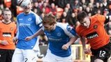 Keith Watson and Liam Craig challenge at Tannadice