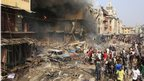 People gather at the site of a fire on Lagos Island in Lagos, Nigeria, on Wednesday, 26 Dec 2012