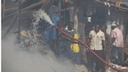 Local men try to fight a fire on Lagos Island in Lagos, Nigeria, on Wednesday, 26 Dec 2012