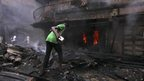 A man tries to put out a fire in Lagos Island (26 Dec 2012)