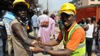 Emergency official gives first aid to injured victim in Lagos (26 Dec 2012)