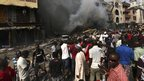 Crowds watch as homes burn on Lagos Island (26 Dec 2012)